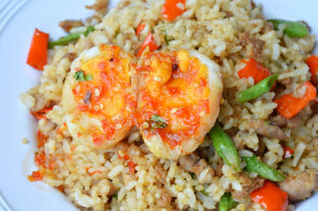 basil  leaf: spicy fried rice with minced pork and basil leaf topping sweet egg Stock Photo