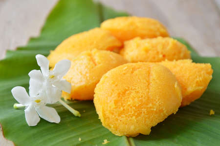 toddy palm: toddy palm cake Thai dessert and cape jasmine on banana leaf