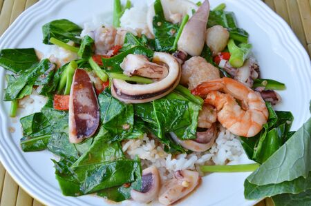 digest: stir fried Chinese kale with mixed seafood on rice