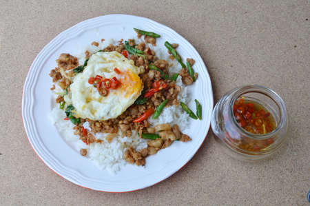 basil  leaf: spicy stir fried minced pork with basil leaf topping egg on rice