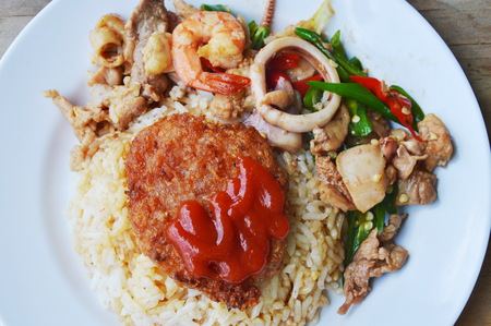 stir fried mixed seafood with sweet long chili and deep fried pork on rice