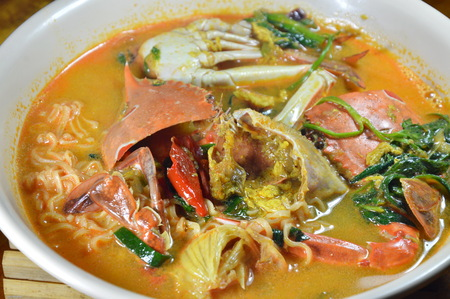 blue swimmer crab: boiled instant noodle with flower crab curry on bowl