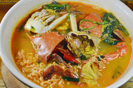 blue swimmer crab: instant noodle with flower crab curry on bowl