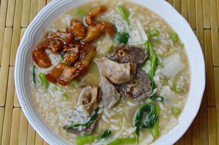 entrails: soft boiled rice with pork entrails on bowl