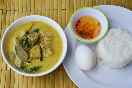 boiled egg: boiled egg on rice and spicy fish ball green curry Stock Photo