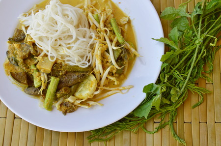 rice noodle with fish curry sauce and fresh vegetable Stock Photo