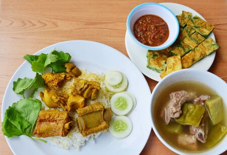 pork rib in yellow curry on rice with fried egg and soup