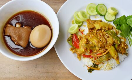 sweet and savoury: stir fried wild boar with red curry and boiled egg in Chinese brown soup Stock Photo