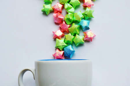 fling: colorful star paper fling from coffee cup on white background