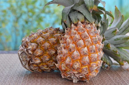 healthy economy: pineapple on bamboo mat