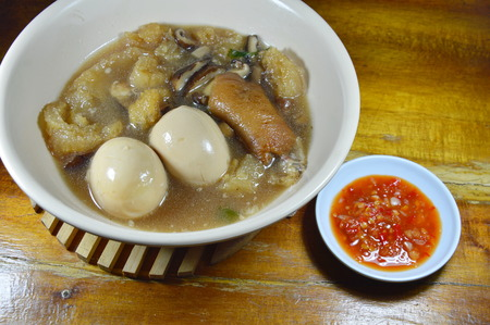 red braised: braised fish maw in red gravy topping boiled egg and spicy chili sauce