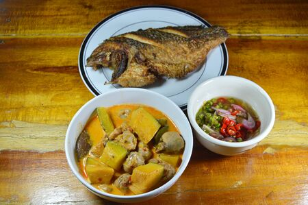 mango fish: spicy pumpkin in coconut cream curry and deep fried mango fish