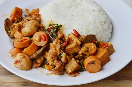 basil  leaf: spicy stir fried mixed sausage and meat with basil leaf on rice