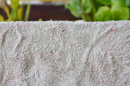 frowzy: dry old towel in air on backyard garden Stock Photo