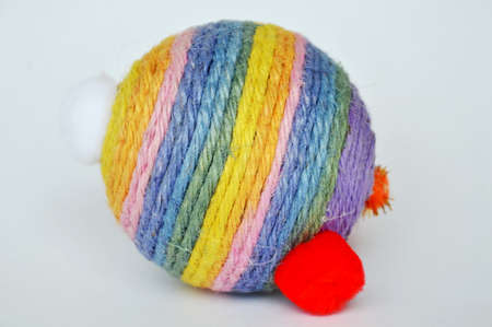 swaddle: dog and cat toy ball wrap colorful hemp rope on white background