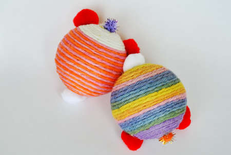 pet toy ball wrap colorful hemp rope on white background