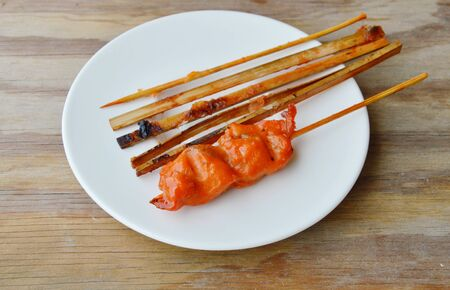 wooden stick: grilled chicken and wooden stick on dish Stock Photo