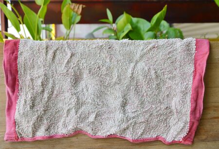 frowzy: dry old towel in air on wooden board