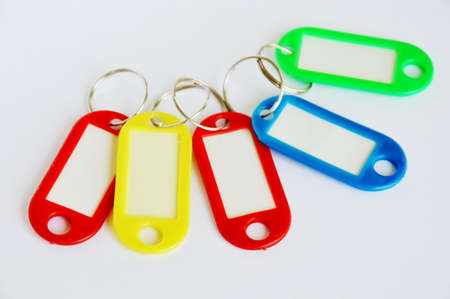 colorful plastic name tag on white background Stock Photo