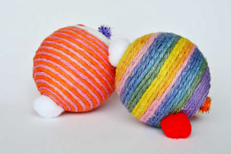 dog and cat toy ball wrap colorful hemp rope on white background