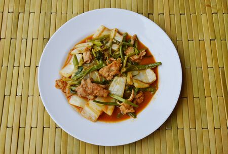 digest: stir fried mixed vegetable and pork in sukiyaki sauce on dish
