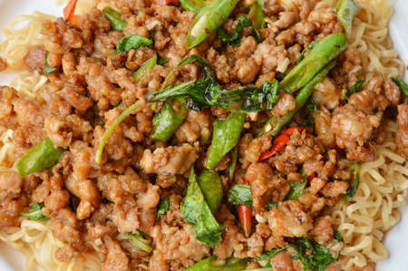 instant noodle topping spicy stir fried minced pork and basil leaf on dish