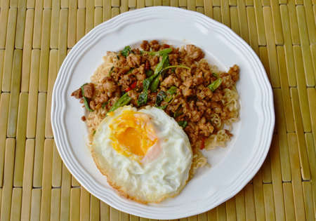 basil  leaf: instant noodle topping spicy stir fried minced pork and basil leaf with egg Stock Photo