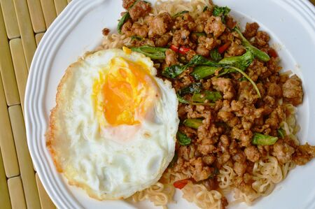 long bean: instant noodle topping spicy stir fried chop pork and basil leaf with egg