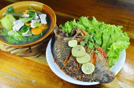 mango fish: deep fried mango fish dressing sweet chili sauce and mixed vegetable soup