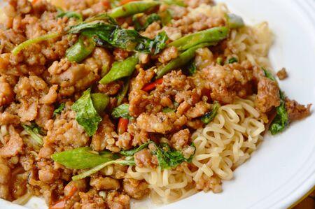 basil  leaf: instant noodle topping spicy stir fried minced pork and basil leaf on dish