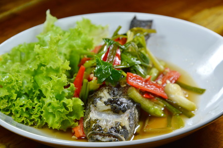 fish plate: steamed sand goby fish with soy sauce on plate Stock Photo