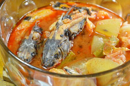boiled mullet with mixed vegetable in spicy and sour soup on bowl Stock Photo