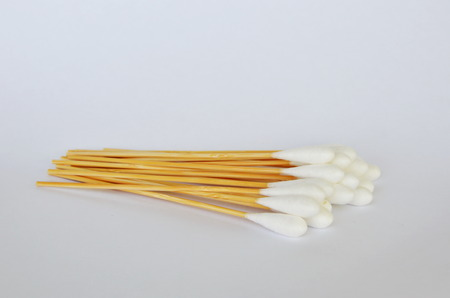 cotton bud: cotton bud with long wooden stick on white background