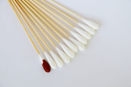 cotton bud: cotton bud with iodine solution on white background