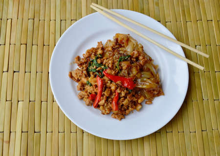 basil  leaf: fried large noodle and spicy minced pork with basil leaf on dish Stock Photo