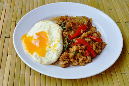 basil  leaf: fried large noodle and spicy minced pork with basil leaf topping egg Stock Photo