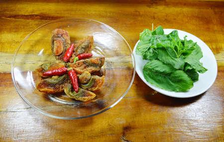 basil  leaf: black preserved egg and basil leaf prepare to cook