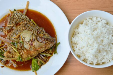 mango fish: deep fried mango fish head dressing ginger and soy sauce with plain rice