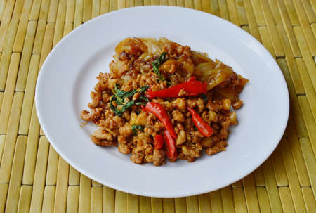 basil  leaf: fried rice noodle and spicy minced pork with basil leaf on dish Stock Photo