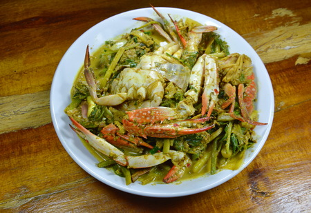 stir fried blue swimmer crab in yellow curry on dish
