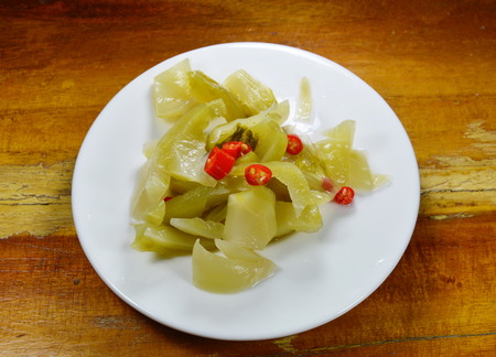 food preservation: spicy pickled cabbage salad on dish