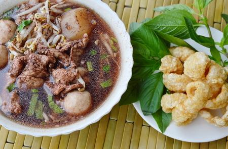 basil  leaf: boiled pork ball in brown soup and basil leaf