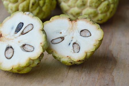sweetsop: sweetsop tropical fruit cut on wooden board
