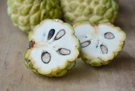 custard apple tropical fruit cut on wooden board Stock Photo