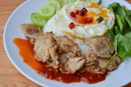 fried pork with garlic and pepper topping creamy egg yolk on rice