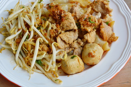 large bean: rice noodle with pork ball dressing black sweet soy sauce on dish