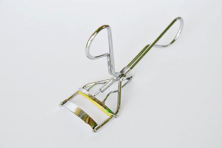 curler: eyelash curler on white background Stock Photo