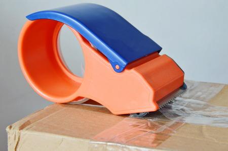 seal brown: tape dispenser seal brown box on for sending