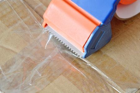 seal brown: tape disperser seal brown box on for sending Stock Photo
