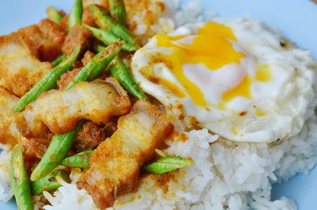 long bean: spicy stir fried crispy pork and yard long bean in curry and creamy egg yolk